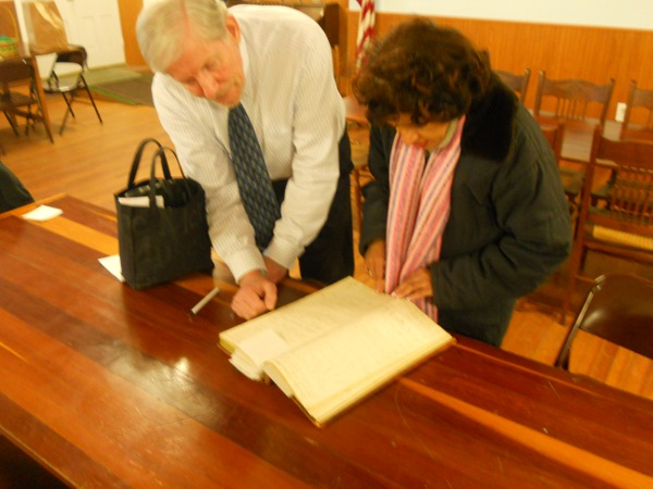 Pastor Ralph Christianson of the Brooklyn (PA) Historical Society showing country store ledger, circa 1845-1849, to DFCLT President Denise Dennis, on March 28, 2013.
